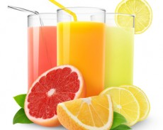 Fresh citrus juices isolated on white